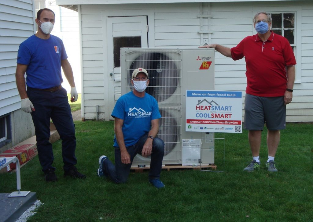 Left to right: Renato Mile (installer from New England Ductless), Craig Forman (coach for HeatSmart Newton), and Tim Tippett (homeowner)